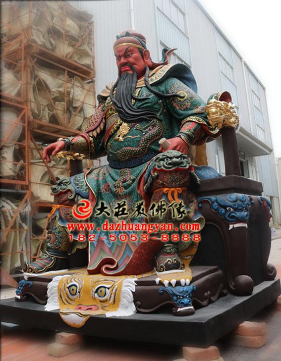 铜雕关公侧面彩绘神像